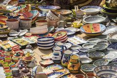 hand-painted dishes of a multitude of colors in a traditional ar Stock Photo