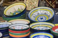 hand-painted dishes of a multitude of colors in a traditional ar Royalty Free Stock Photo