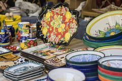 hand-painted dishes of a multitude of colors in a traditional ar Royalty Free Stock Photography