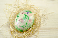 Hand painted Easter egg and straw nest Royalty Free Stock Photography