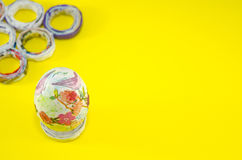 Hand painted Easter egg on yellow background Stock Photos