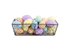 Hand-Painted Easter Eggs in Chicken Wire Tray Cut Out. Cut out of hand-painted easter eggs in a chicken wire tray royalty free stock image