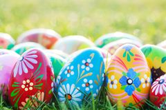 Hand-painted Easter eggs on grass. Spring patterns Stock Photography