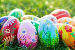 Hand painted Easter eggs on grass. Spring patterns Stock Photo