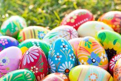 Hand-painted Easter eggs on grass. Spring patterns Stock Images