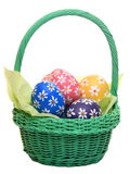 Hand painted easter eggs in green basket Stock Photo