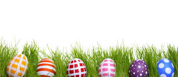Hand-painted Easter eggs hidden in the grass Stock Image
