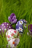 Hand-painted Easter eggs hidden in the grass Stock Photography