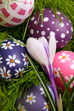 Hand-painted Easter eggs hidden in the grass Stock Photo