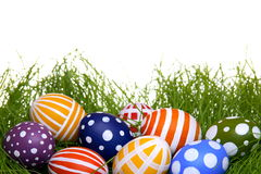 Hand-painted Easter eggs hidden in the grass Stock Images