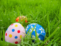 Hand painted Easter eggs hidden on the grass Stock Photo