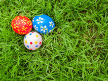 Hand painted Easter eggs hidden on the grass Royalty Free Stock Image
