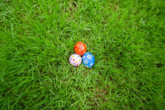 Hand painted Easter eggs hidden on the grass Royalty Free Stock Photos