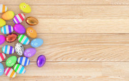 Hand Painted Easter Eggs. Multicoloured Easter Eggs on a wooden floor Royalty Free Stock Photos