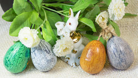 Hand painted Easter eggs and porcelain rabbit Royalty Free Stock Images