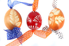 Easter eggs. Hand painted Easter eggs with ribbons stock photography