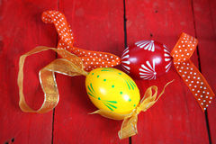 Easter eggs. Hand painted Easter eggs with ribbons in a red wooden crate royalty free stock images