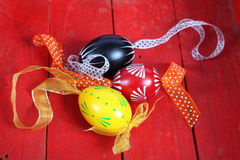 Easter eggs. Hand painted Easter eggs with ribbons in a red wooden crate royalty free stock image