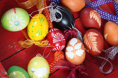Easter eggs. Hand painted Easter eggs with ribbons in a red wooden crate stock photography