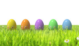 Hand Painted Easter Eggs in Spring Grass. Multicoloured Easter Eggs in Spring Time Grass Stock Photo