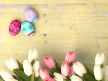 Hand-painted easter eggs with tulips Royalty Free Stock Images