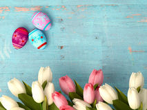Hand-painted easter eggs with tulips Stock Photos