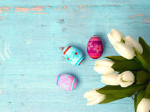 Hand-painted easter eggs with tulips Stock Photography