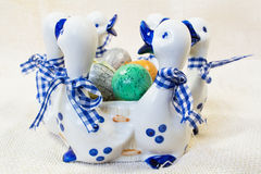 Hand painted Easter eggs in white with blue vase with ducks figures Stock Photography