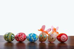 Hand painted Easter eggs on the wooden texture stock photo