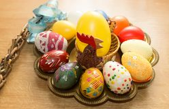 Hand painted eggs on a tray with a hen for easter Stock Photography