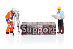 Support word in letterpress with miniature workmen Royalty Free Stock Images