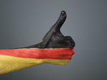 Hand painted with the flag of Germany Stock Photography