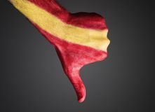 Hand painted with flag Spain expressing negativity. Hand painted with the flag of Spain and expressing negativity and  on dark background Royalty Free Stock Photography
