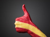 Hand painted with flag Spain expressing positivity. Hand painted with the flag of Spain and expressing positivity and  on dark background Royalty Free Stock Images