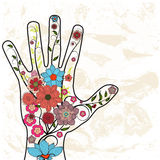 Hand with painted flowers Stock Images