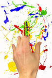 Hand with painted forefinger on background. Hand with painted forefinger on colorful background Stock Image