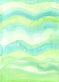 Hand-Painted Fresh Green Watercolor Background Texture. Hand-painted watercolor background texture in wave form with fresh green tones Stock Photo