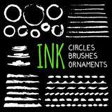 Hand painted ink blobs set. Hand painted ink blobs and brushes set. Hand drawn grunge circles. Black round buttons and strokes. Chalkboard effect. Graphic design Stock Images