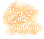 Hand painted lettering You Are My Sunshine on the watercolor background Royalty Free Stock Photo