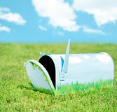 Hand painted mailbox. Open in a grassy setting mimicing its painted scene royalty free stock images