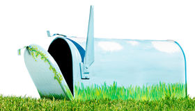 Hand painted mailbox. Open in an isolated grassy setting stock image
