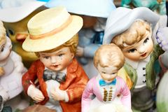 Hand painted male and female figures at a flea market. Closeup of old antique hand painted male and female human figures with hats at a flea market royalty free stock image