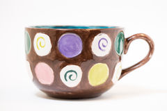Hand Painted Mug Side. A macro selective shot of a hand painted mug in a studio. focus on side of mug Stock Photos