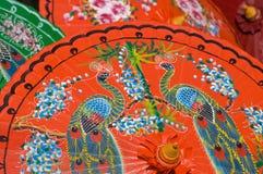 Hand painted orange umbrellas in Thailand Stock Photography
