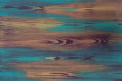 Hand painted plate colorful illusion painting, trompe l`oeil, with creative imitation of wood grain, wooden board. S in bright violet, purple, blue, turquoise royalty free stock photography