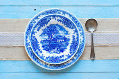Hand painted plate with spoon Stock Image