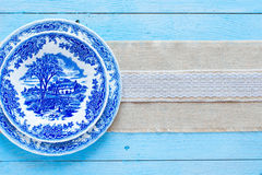 Hand painted plate on wooden background Stock Photos