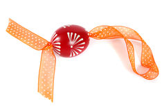 Red easter egg with ribbon. Hand painted red easter egg with orange ribbon on a white background stock images