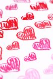 Hand painted red hearts. Pastel chalks Valentine's Day abstract background Stock Image