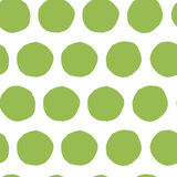 Hand painted seamless polka dot pattern. Abstract green fresh organic background. Stock Photos